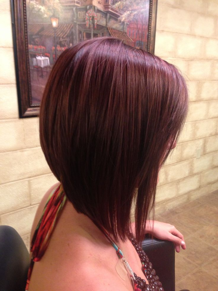 Long angled bob (A-line haircut) with a dramatic angle and gorgeous golden, mahogany-brown color.
