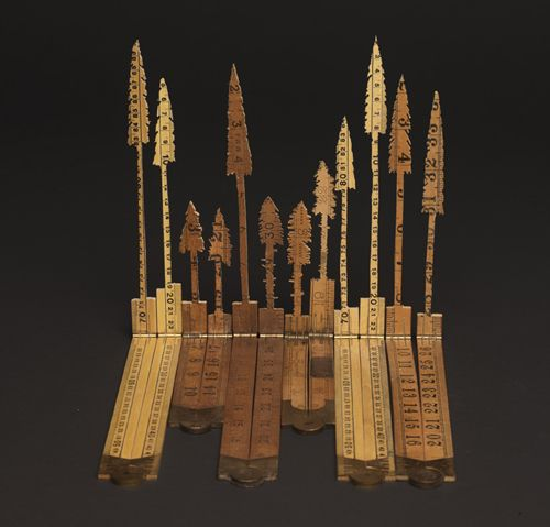 by Lizzie Thomas (folding carpenter rulers--love them!)