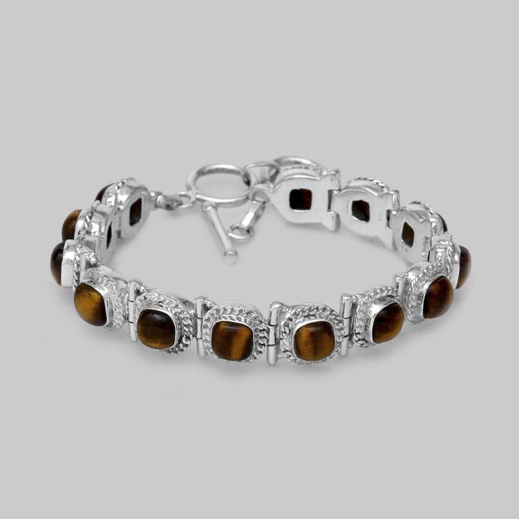 Brăţară mobilă din argint lucrată manual în combinaţie cu ochi de tigru caboșon. Cod produs: EB120 Greutate: 43.13 gr. Lungime: 19.70 - 21.50 cm Lățime: 1.20 cm Reglabil: da Piatră: OCHI DE TIGRU