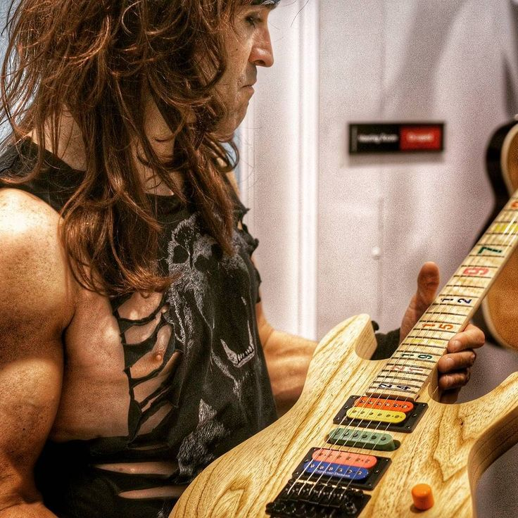 Russ Parrish aka Satchell looking at the Carvin Jason Becker numbers guitar.