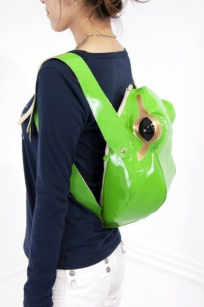 "Kick your schoolday fashion quotient into high gear with the Frog Backpack from Japan's Tokyo Otaku Mode. The shiny (not slimy) backpack features straps disguised as amphibian arms and ""skin"" as green as a new lily pad."