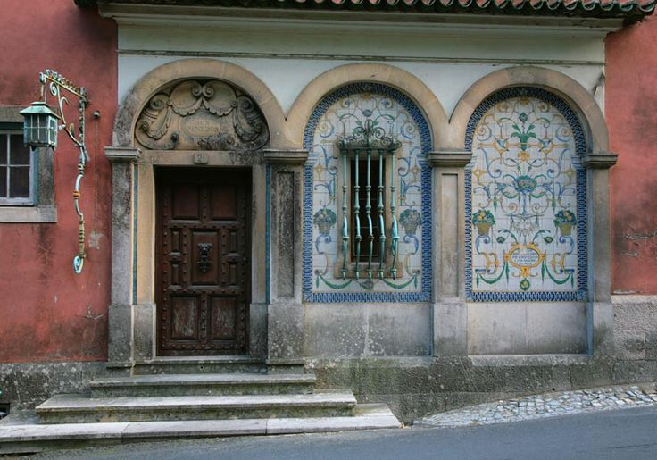 The facade of a house in Sintra. The ornate, eclectic mix is characteristic of the architecture in the town. As is the faded grandeur
