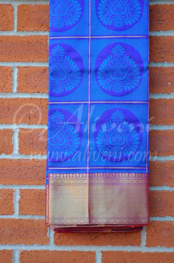 Blue Kuppadam Saree with zari checks and motifs & Rich Magenta Zari Border