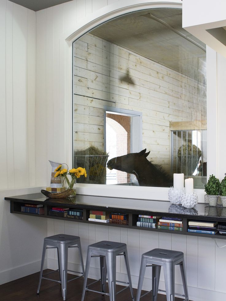 The living room of this converted barn features a large window that looks into the horse stables. http://www.gactv.com/gac/photos/article/0,3524,GAC_42725_6074006,00.html?soc=pinterest
