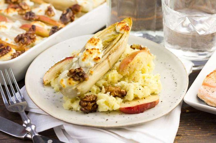 Recept voor witlofschotel voor 4 personen. Met zout, boter, olijfolie, peper, zalmfilet, aardappel, pastinaak, walnoten, geitenkaas, appel, melk en witlof