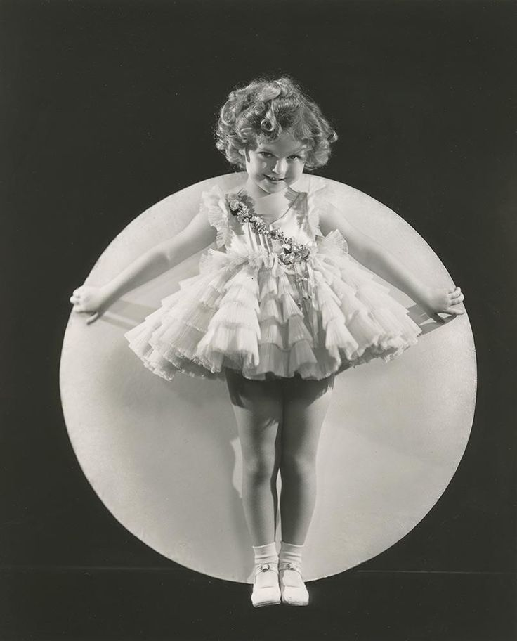 """Shirley Temple in dress worn for film, """"Baby Take A Bow."""" This dress will be shown in the traveling exhibits before being auctioned by Theriault's on July 14, 2015. http://www.theriaults.com"""