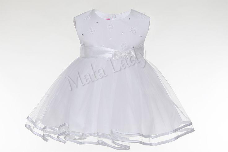 Wspaniała sukienka Ania łączy w sobie niewinność satynowej bieli wraz z delikatnością tiulu obszytego lamówką. Sukienka udekorowana została błyszczącymi cyrkoniami orazdrobnymikwiatuszkami. Całość obszyta płótnem bawełnianym oraz podszewką. Sukienka posiada kryty zamek z tyłu kreacji. Dodatkowo dzięki paskowi z atłasu sukienka przylega do ciała.