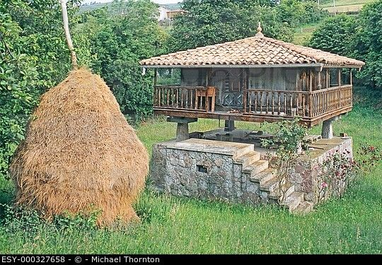 Traditional Stone Granary Horreo with Haystack in Asturias.