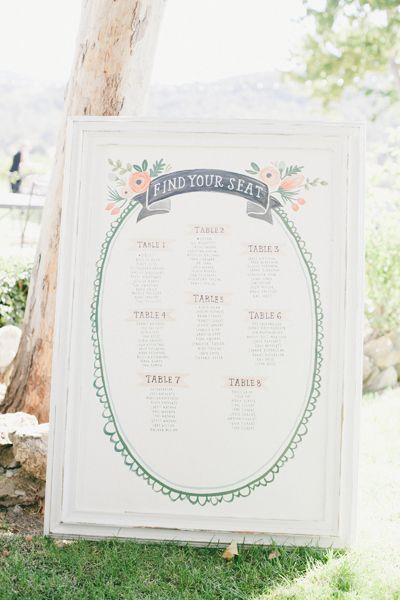 This vintage-inspired seating chart blends in (in a good way!) with its scenic outdoor surroundings. Consider matching the typeface from your wedding invites or programs for a cohesive style.