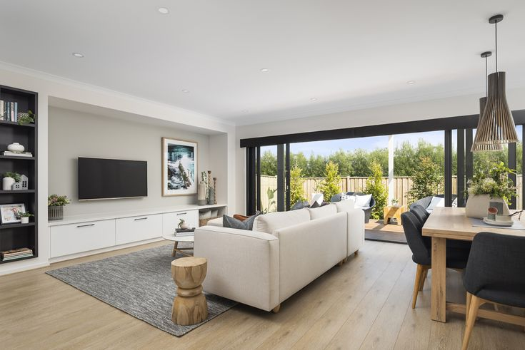 A warm colour palette of refreshing cream whites and contrasting black highlights is beautifully complimented by natural materials such as timbers.