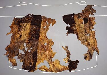 The remains of Ötzi's goatskin coat, from the Copper Age, over 5,000 years ago. Scientific investigations indicate that the hides were tanned using fat and smoke. Once tanned, the sections were carefully cross-stitched together. The stitching was done with the fibres of animal sinews. The coat was worn with the fur side out. Darker stripes were alternated with lighter ones to produce a striking pattern.