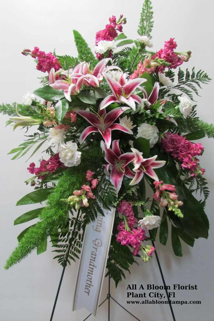 1243 best sympathy flowers images on pinterest floral arrangements standing easel spray with stargazer lilies purple stock white carnations and white cushions funeral flower izmirmasajfo
