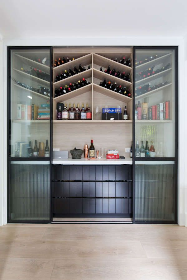 Chevron Pattern Wine Storage Behind Black Framed Glass Sliding Doors Shelves Kitchen