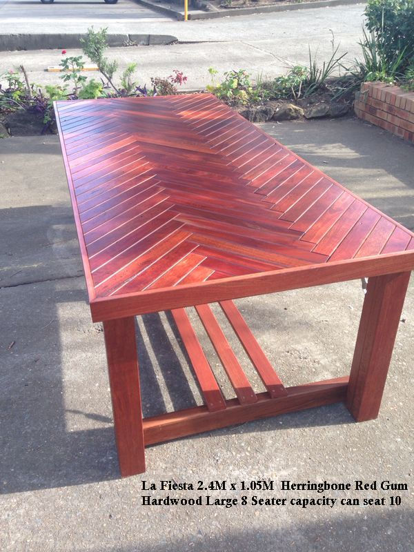 La Fiesta Australian Red Gum Herringbone Hardwood with natural rustic features 2.4M x 1.05M Large 8 seater Dining Table with the capacity to seat 10 One-off display piece on sale reduced to $1300.00 o.n.o. at www.timberfloors.com.au or phone 02 9756 4242