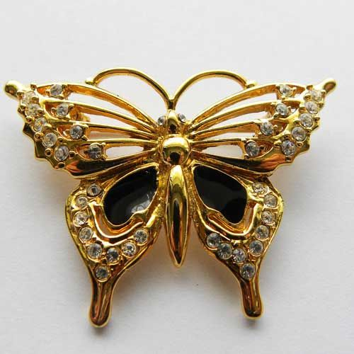Beautiful diamante brooch of a butterfly design with black enamel detail Combined with gold tone this butterfly brooch is just great to wear: