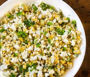 Fresh corn kernels charred over fire and slathered in a cilantro lime cream sauce with feta cheese, onions and seasoning. Serve as a side to any summer di