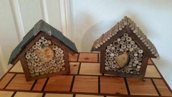 Garden insect hotel one with a real slate roof and the other has a willow stick roof both are aprox 7 inch by 9 inch and filled with drilled garden canes and tree logs. If you are worried about the shipping cost or postage in UK please get in touch thanks Mark