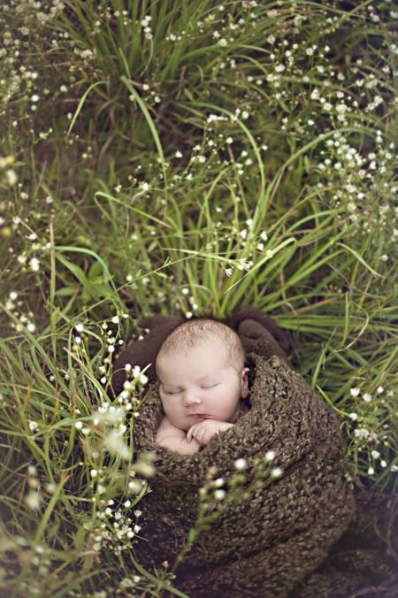 Outdoor newborn photography. I like this idea for all of the babies if they're born in different seasons