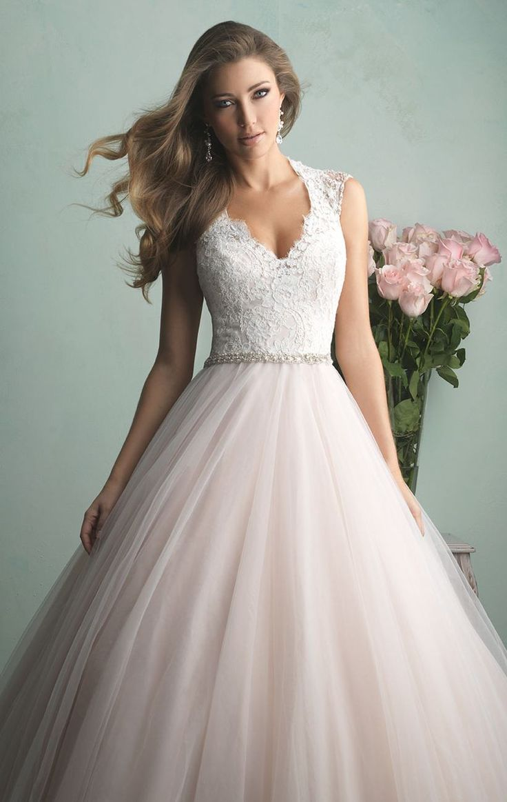 Do a graceful walk in Allure Bridals 9162. This majestic wedding gown features cap sleeves. With gorgeous lace bodice and beaded back designs. A ballgown skirt with train will make you look congenial.