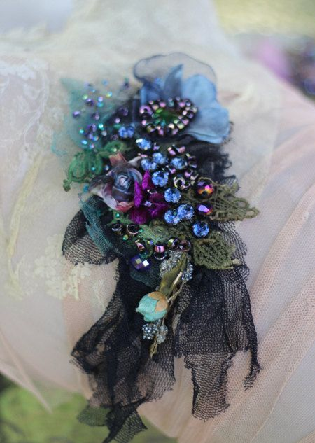 Romantic bold brooch with handmade bloom is made of vintage and antique textiles and trims-antique handmade lace, tulle, vintage trims,. Hand