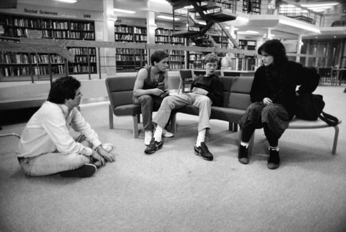 """Here's a look behind the scenes of """"The Breakfast Club"""" (1985). Director/writer John Hughes (left) with Emilio Estevez, Anthony Michael Hall and Ally Sheedy.  (Image via Margaret Herrick Library)"""