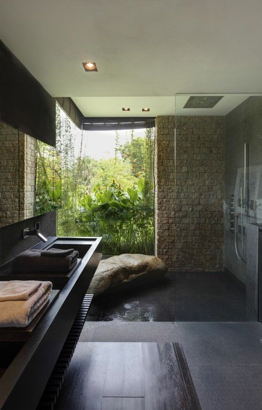 What an amazing nature styled bathroom. I love that rock bench in the shower.