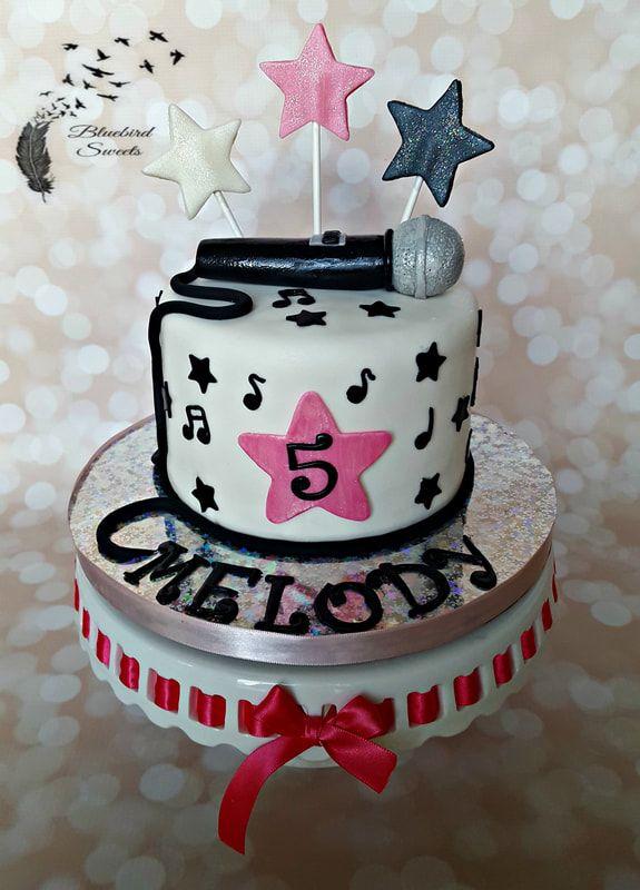 Rock star girl birthday cake with microphone and stars. Music cake