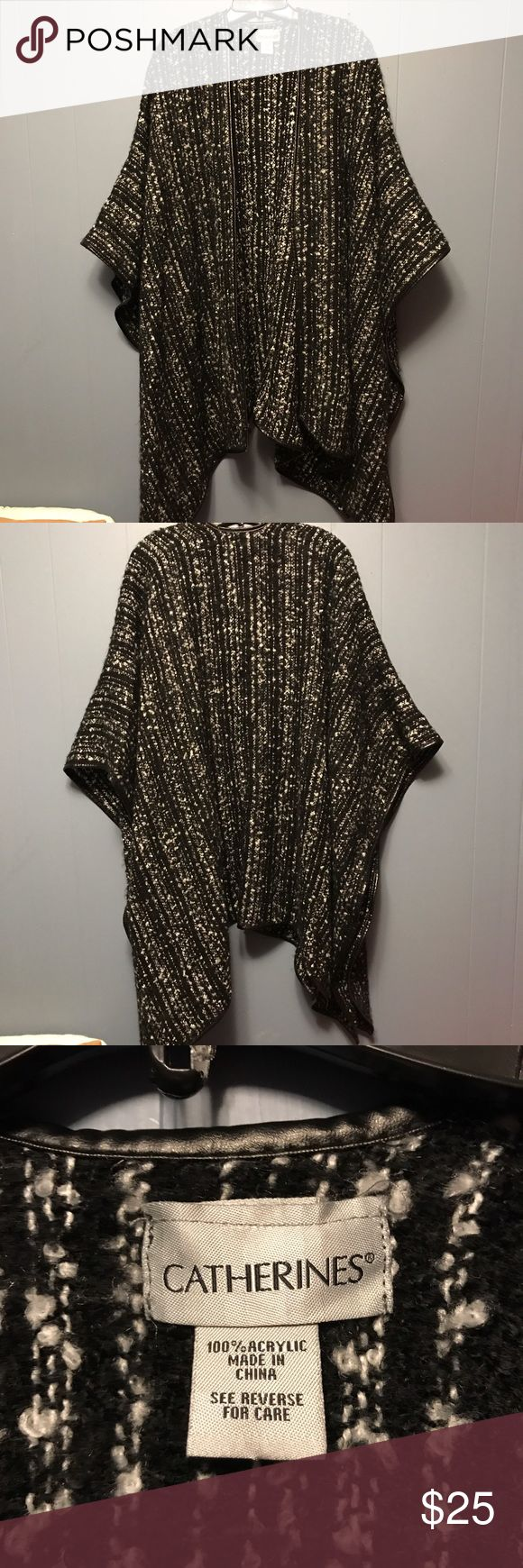 Catherines Blanket Wrap Blanket wrap/shawl. Black and white. One size. Doesn't have arm holes in it. Feel free to make an offer. Catherines Sweaters Shrugs & Ponchos