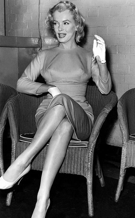 """Marilyn Monroe at a press conference on her arrival in England to film """"The Prince and The Showgirl"""", 1956."""