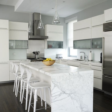 This is an example of too austere for me; I wouldn't wrap the marble around, I would use different chairs (color or wood) and I would use different hardware.  It's definitely turning me off the marble on white idea.