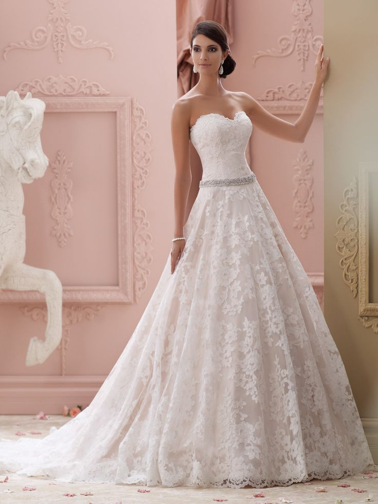 2015 Wedding Dress Collection – Strapless allover re-embroidered lace over luxurious satin ball gown wedding dress with scalloped sweetheart neckline, hand-beaded and jeweled natural waistline, scalloped back bodice with covered buttons, softly gathered full skirt with scalloped hemline and chapel length train, detachable spaghetti and halter straps included. Embellish by David Tutera ring style Elizabeth, earring [...]