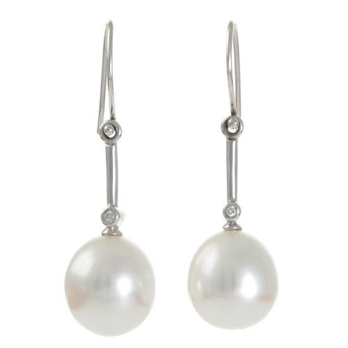 A pair of drop-shaped white South Sea pearl and diamond hook earrings in 18ct white gold with pearls measuring 12.2 - 12.3mm with a good lustre and few natural surface marks. The pearls are set below a shepherd's hook with a fixed bar and single bezel set diamond. #Rutherford #Melbourne