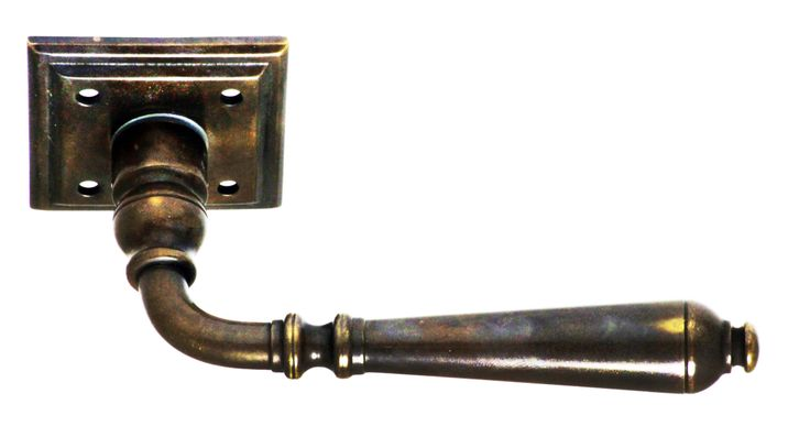 Classic French door lever shown in aged brass.