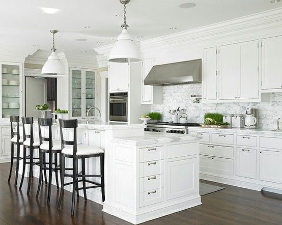 white, marble, and a splash of black with dark timber floors