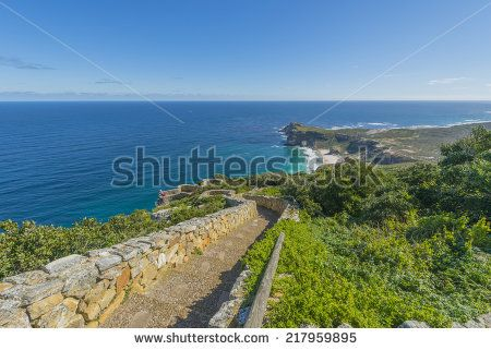 http://www.shutterstock.com/pic-217959895/stock-photo-cape-point-is-located-near-the-city-of-cape-town-south-africa-the-peninsula-has-towering-rock.html?src=l2UmwzKl67EMHu1DgRoo8g-1-38 Cape Point Is Located Near The City Of Cape Town, South Africa. The Peninsula Has Towering Rock Cliffs And Lighthouse That Overlook The Beautiful Ocean View. A Tourism And Travel Hot Spot. Stock Photo 217959895 : Shutterstock