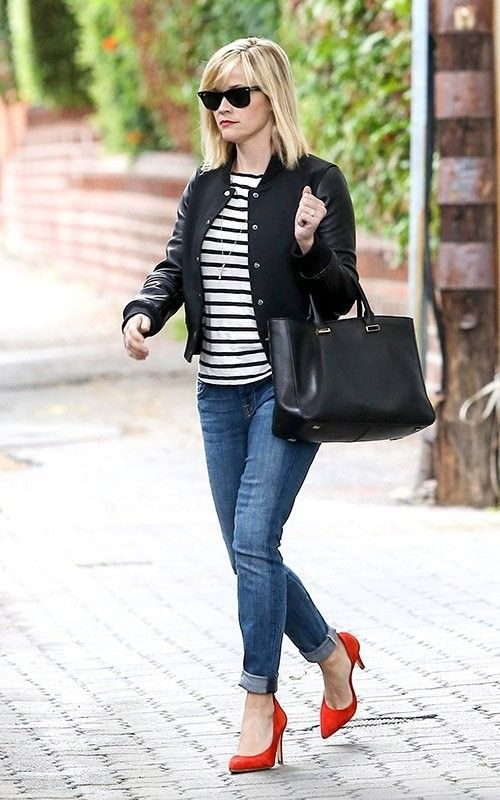 Shop Reese Witherspoon's look for $130:  http://lookastic.com/women/looks/varsity-jacket-and-crew-neck-t-shirt-and-shopper-handbag-and-jeans-and-heels/1822  — Black Varsity Jacket  — White and Black Horizontal Striped Crew-neck T-shirt  — Black Leather Shopper Handbag  — Blue Jeans  — Red Suede Heels