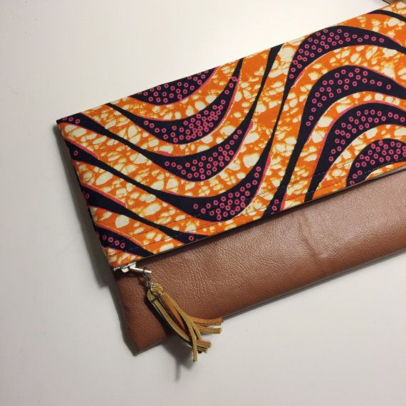 This foldover clutch is made from authentic African wax print material and faux leather on Zipped & Printed on etsy!