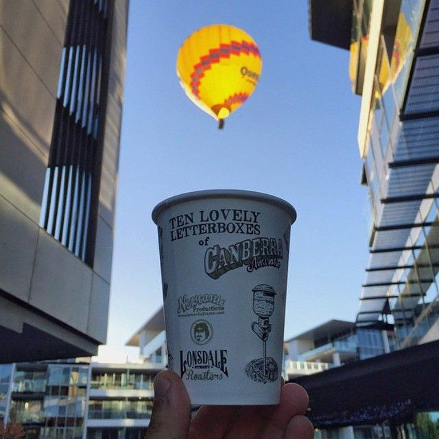 """""""Mornings at Remedy."""" @remedybylsr_kingston shared this creative image from their home on the Kingston Foreshore, a vibrant waterfront precinct with a strong arts, cultural, recreation and dining presence. If only all coffee came with a hot air balloon! #visitcanberra #restaurantaustralia"""