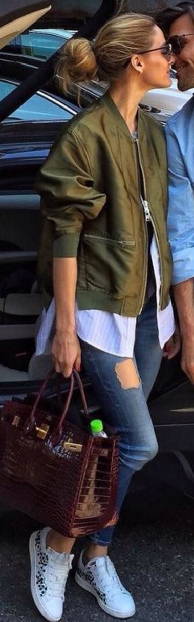 Who made Olivia Palermo's green bomber jacket, sneakers, blue skinny jeans, and red tote handbag?