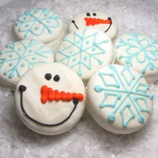 Oreo Snowmen ... (couldnt find the link but I'm guessing you just dip the cookie into white melting chocolate and pipe on the frosting face) ...