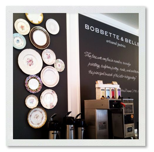 Black wall panel with decorative plates. Could do this with chalkboard paint and plates. Just an idea!