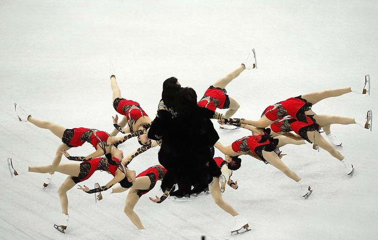 Pang and Tong of China perform during the pairs' short program at the ISU Grand Prix of Figure Skating Final in Sochi, Russia.