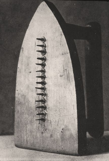 The Gift by Man Ray, 1921. This piece was made in the afternoon on the opening day of Man Ray's first solo show in Paris. It was intended as a gift to the gallery owner, the poet Philippe Soupault, and Ray added it to the show at the last minute.