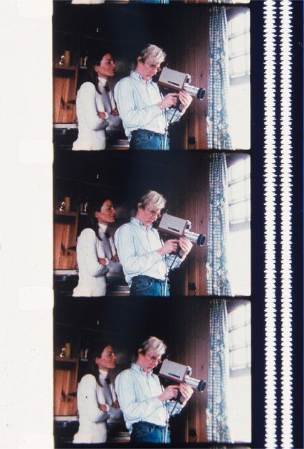 Andy Warhol filming through the window with Lee Radziwill looking over his shoulder, Montauk, August 1972. Credit Jonas Mekas