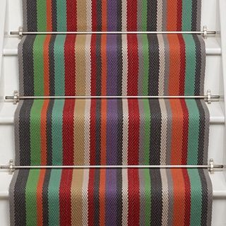 Use a vibrant colourful stair runner carpet to brighten up your hall and stairway.   Multi-coloured stair runner from Roger Oates Kyoto Lantern