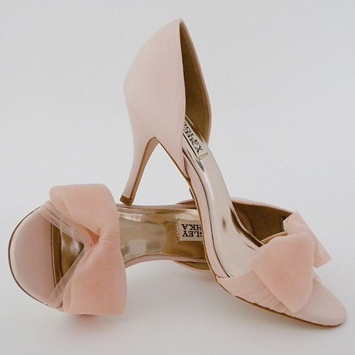"Classic D'Orsay styling on a 3"" heel, Open toe is wrapped in tulle & finished with a tulle bow. Designed by Badgley Mischka. Usually ships in 2-3 business days."