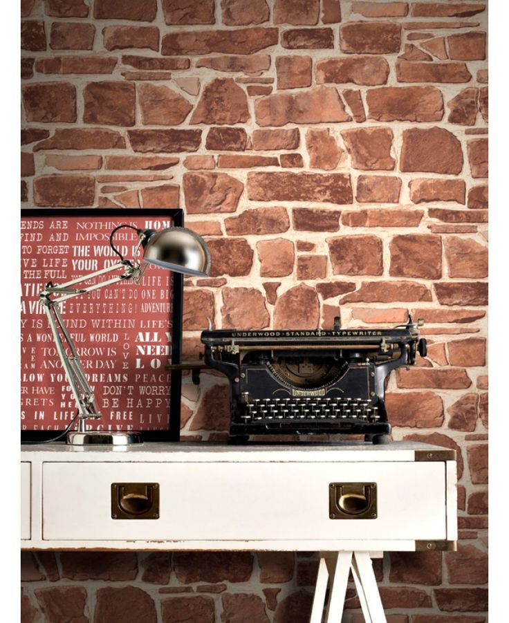 This fantastically realistic Stone Wall Wallpaper features a rustic stone wall print in natural tones of brick red. The design is printed on to high quality textured paper for added effect and to ensure durability and a quality finish