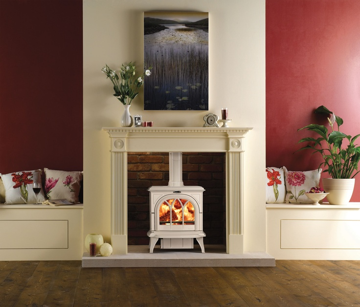 Stovax Huntingdon 30 Multi-fuel Stove in Ivory Enamel and a Tracery door shown here burning logs and with a Stovax Georgian Mantel. The elegant Huntingdon stove looks equally stunning within a cosy cottage inglenook as it does hearth mounted in a Georgian townhouse. #stovax #stove #woodburning #multifuel #woodburner