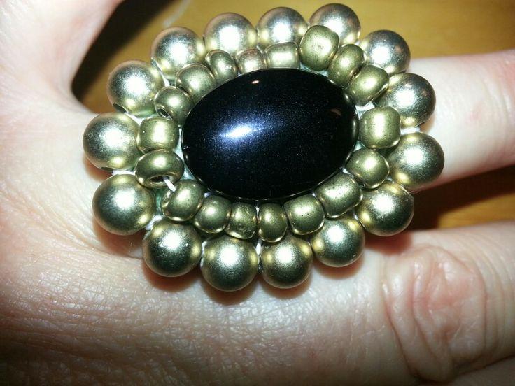 Black & gold glass beads on crochet ring