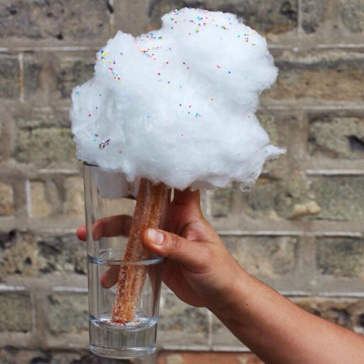 Vanilla Cotton Candy spun onto a Cinnamon Sugar Churro    Gourmet cotton candy available from Fluffpop. www.fluffpop.com. Gluten-free, vegan, organic, and kosher options available. #fluffpop #gourmetcottoncandy #cottoncandy #healthydessert #weddingideas   Photo credit: unknown.  To credit photo, please email info@fluffpop.com and we will update our records.